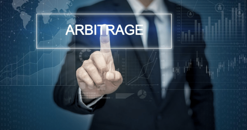 businessman points his finger at the word Arbitrage